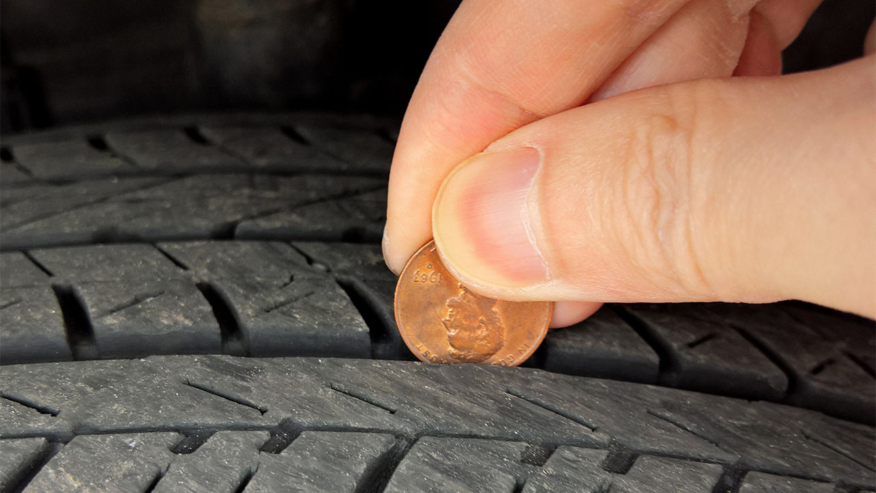 """Featured image for """"The Penny Test for Tires: What It Is and Why It's Critical for Tire Maintenance"""""""